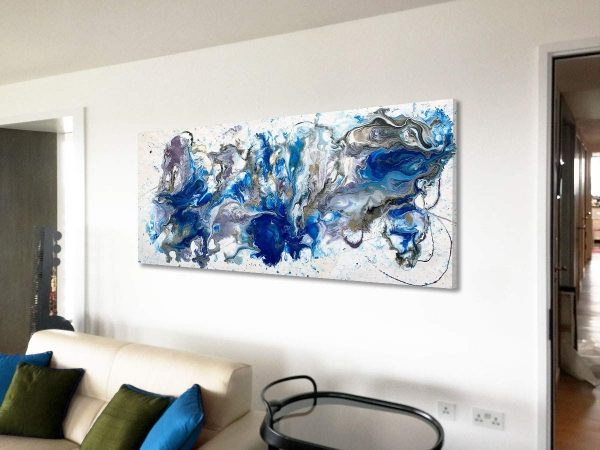 large blue and white original art on a white wall