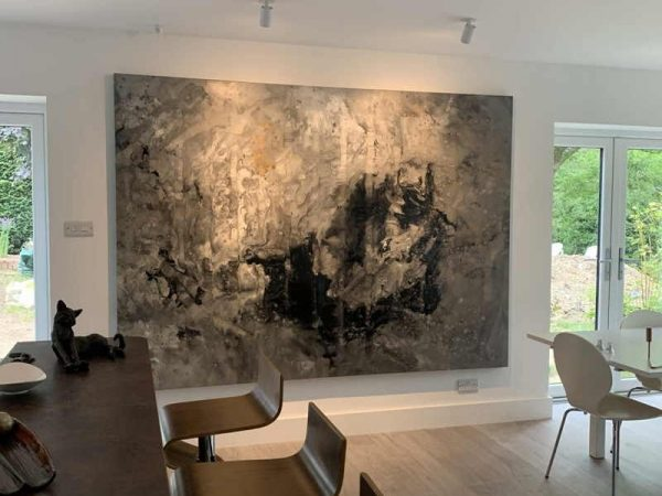 large grey and white abstract painting in open plan kitchen