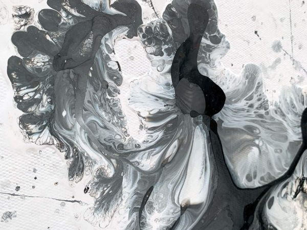 details of black and white paints on canvas