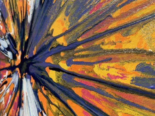 details of blue pink and orange paint on canvas