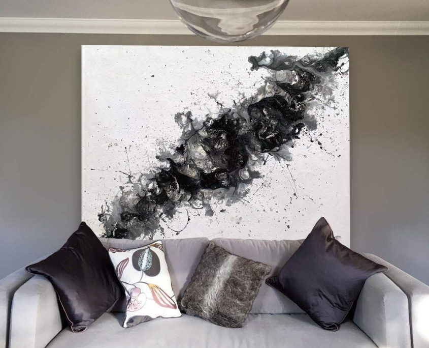 large black and white painting in a living room space