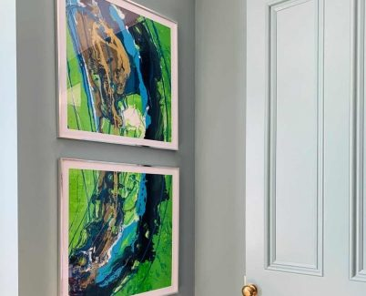 two square green and blue original abstract art works in frames