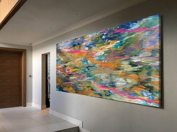 very big coloured abstract painting in a hallway