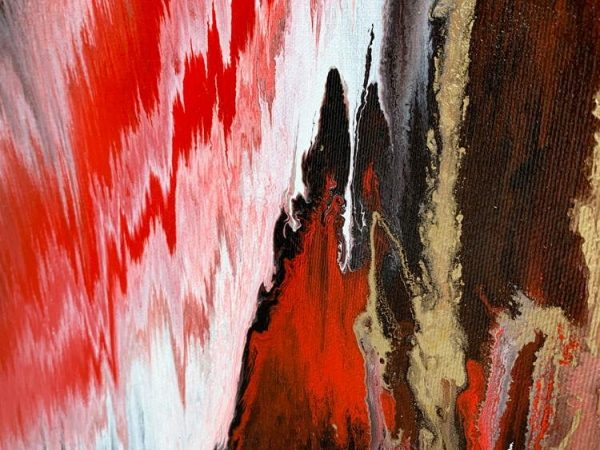 details of red and gold paint on canvas