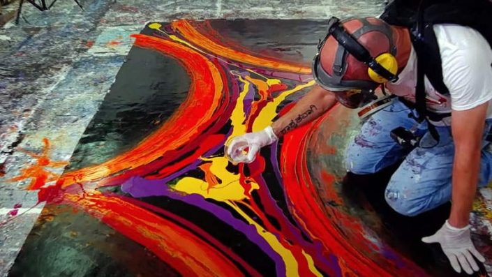 large red and purple art being created