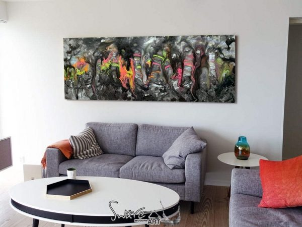 long black and grey art above a sofa