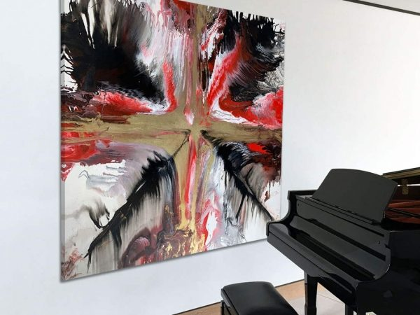 red black and gold art next to piano