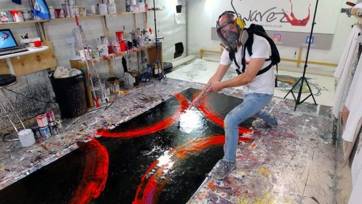 red-fluorescent-painting-being-created