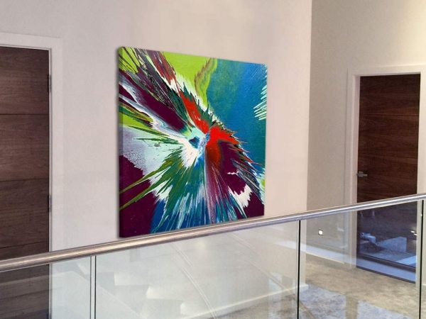 square painting on landing next to glass balustrade