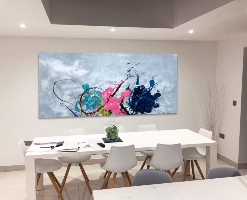 white dining table and rectangular abstract art behind