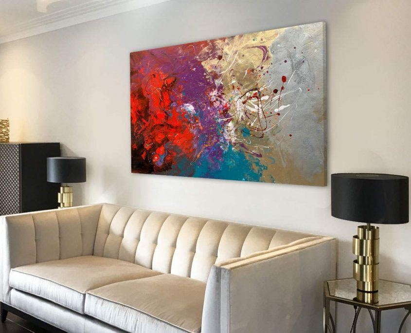 abstract painting above a sofa