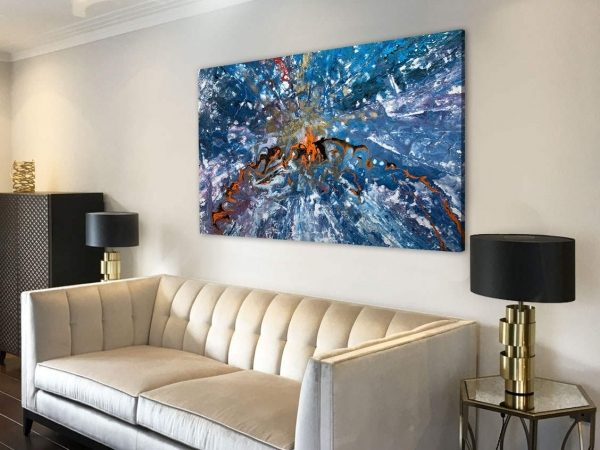 gold sofa and blue painting