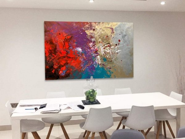 red and purple art above a dining table