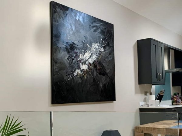 black and white modern art in clean open living space