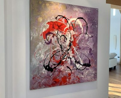 pink and red abstract art in modern living space