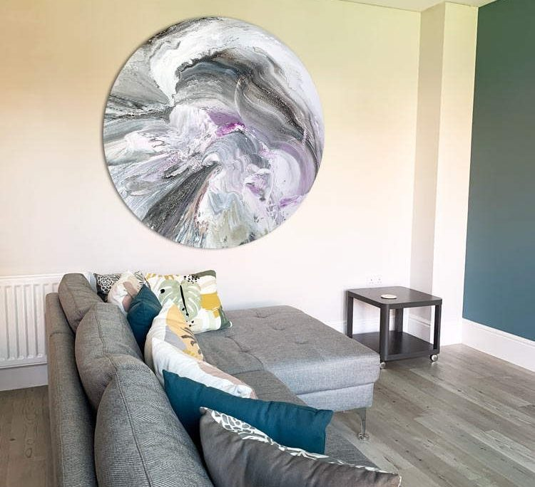 round large canvas painting in a living room