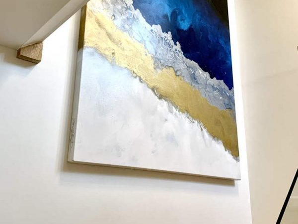 tall blue and gold art in a stairwell