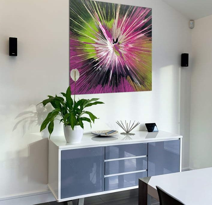 abstract art above a console table