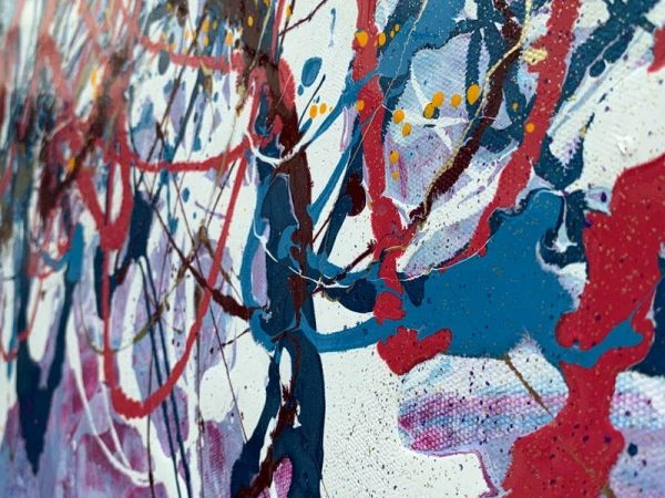 details of magenta and blue paint on canvas