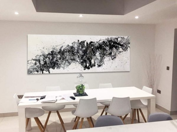 black and white abstract in a dining room space