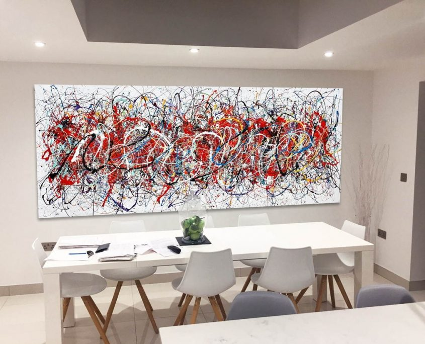 dining table and massive original modern art behind