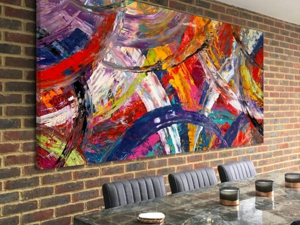 large multi coloured abstract art on a brick wall
