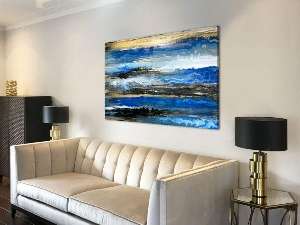 long blue and gold art above a sofa