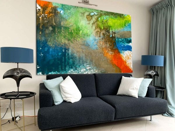 multi coloured abstract painting and sofa
