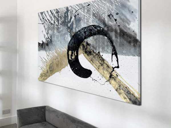 black and gold art above a chair