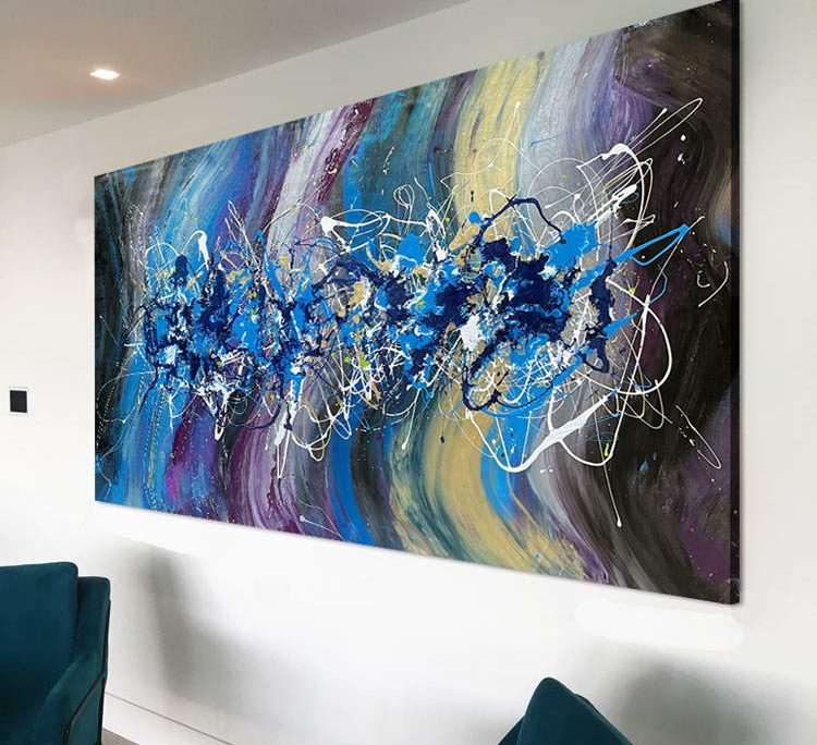 big gold and purple painting on a white wall