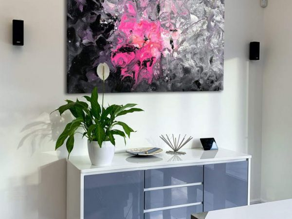 pink and purple art above console table