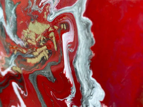 red and white streaks of paint