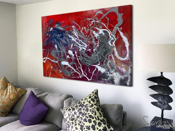 silver and red abstract art on a wall