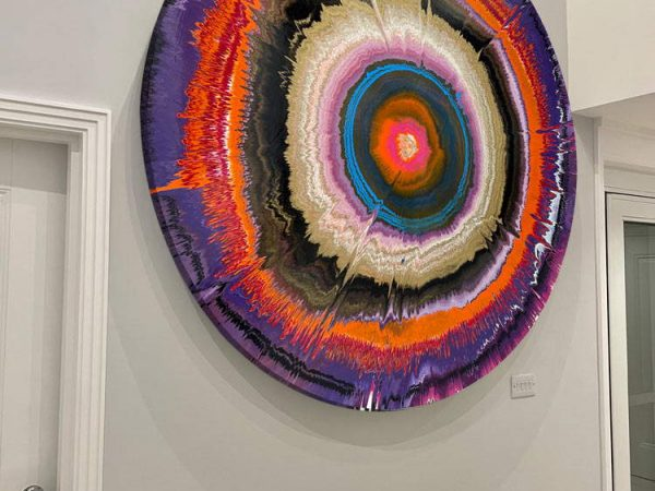 round abstract painting on a wall