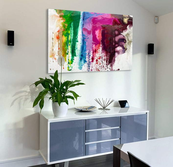 colourful art above console table