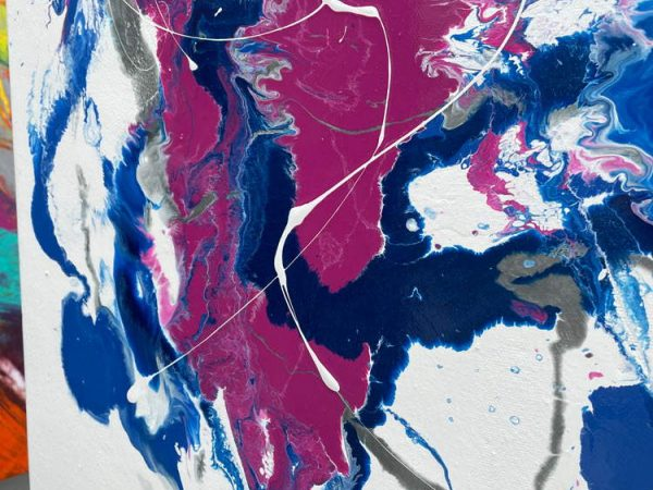details of blue and pink paint on a painting