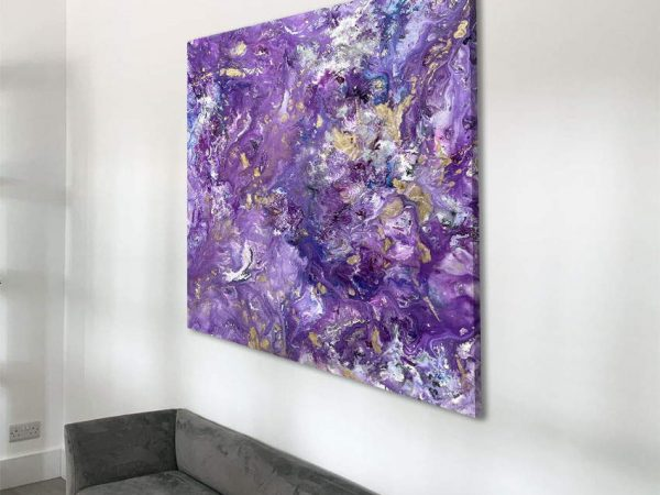 mauve and lilac painting above a sofa