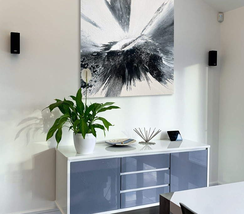 small art above a console table