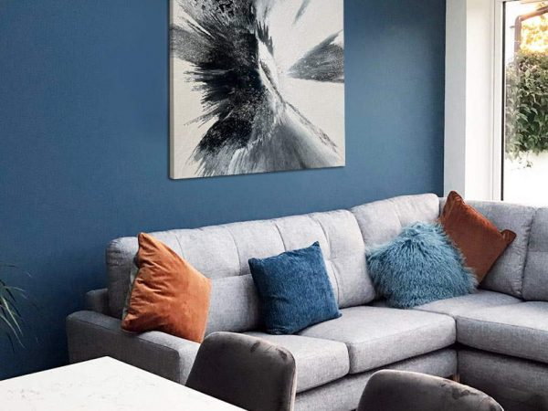 square black and white painting on a blue wall