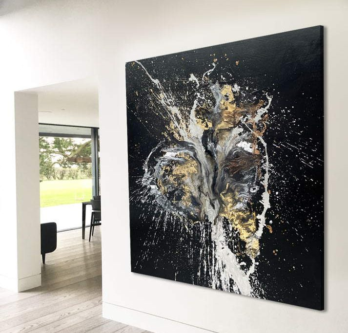 very large black painting with gold and silver on a wall