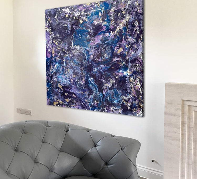 blue and lilac artwork on a wall