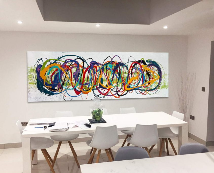 large rainbow art in a dining room