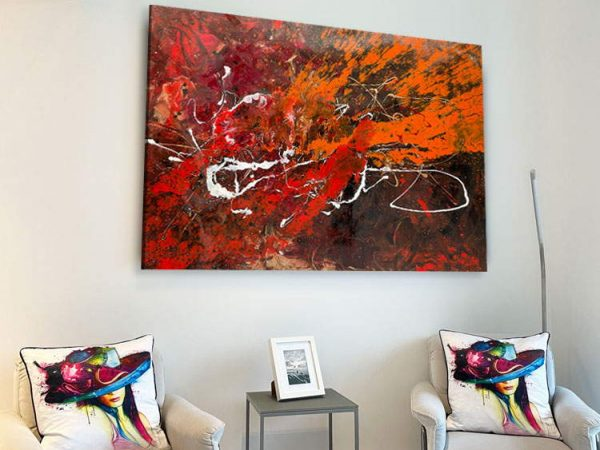 orange and red painting on a high wall