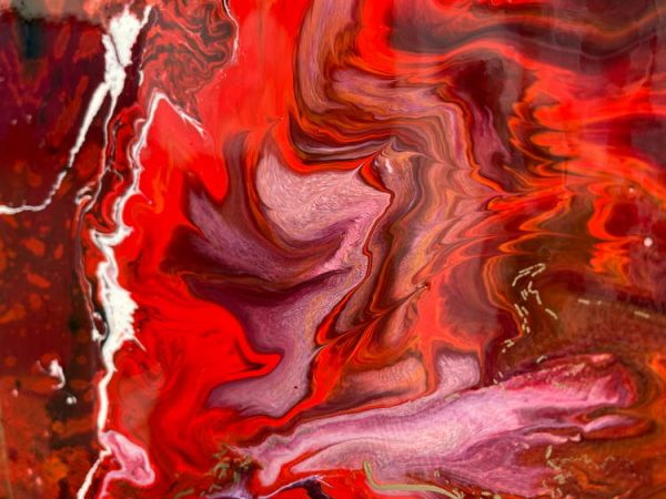 red splashed paint on canvas