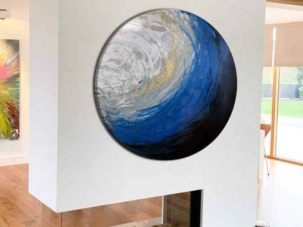 round canvas art on a fireplace