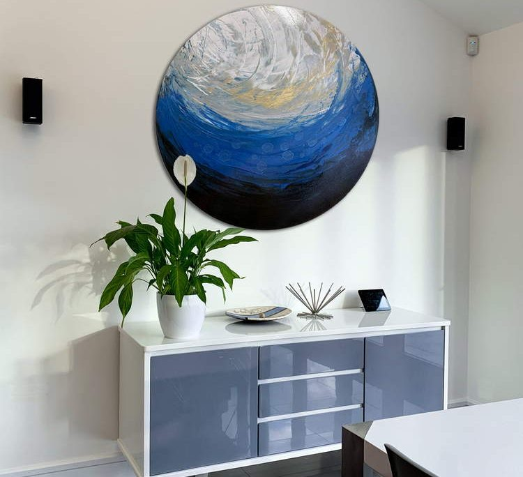 round painting above a console